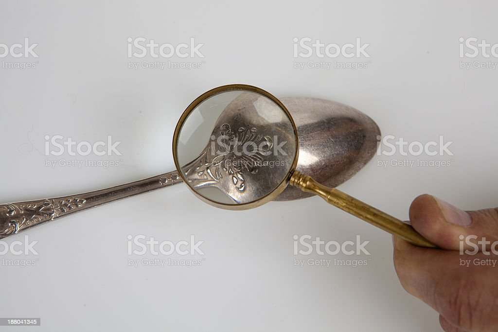 Teaspoon and magnifying glass, stock photo