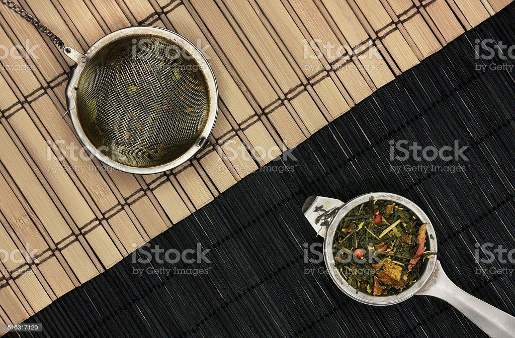 Tea-strainers on wooden diagonal stock photo