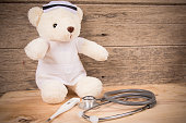 tebby bear wear nurse with stethoscope and thermomete