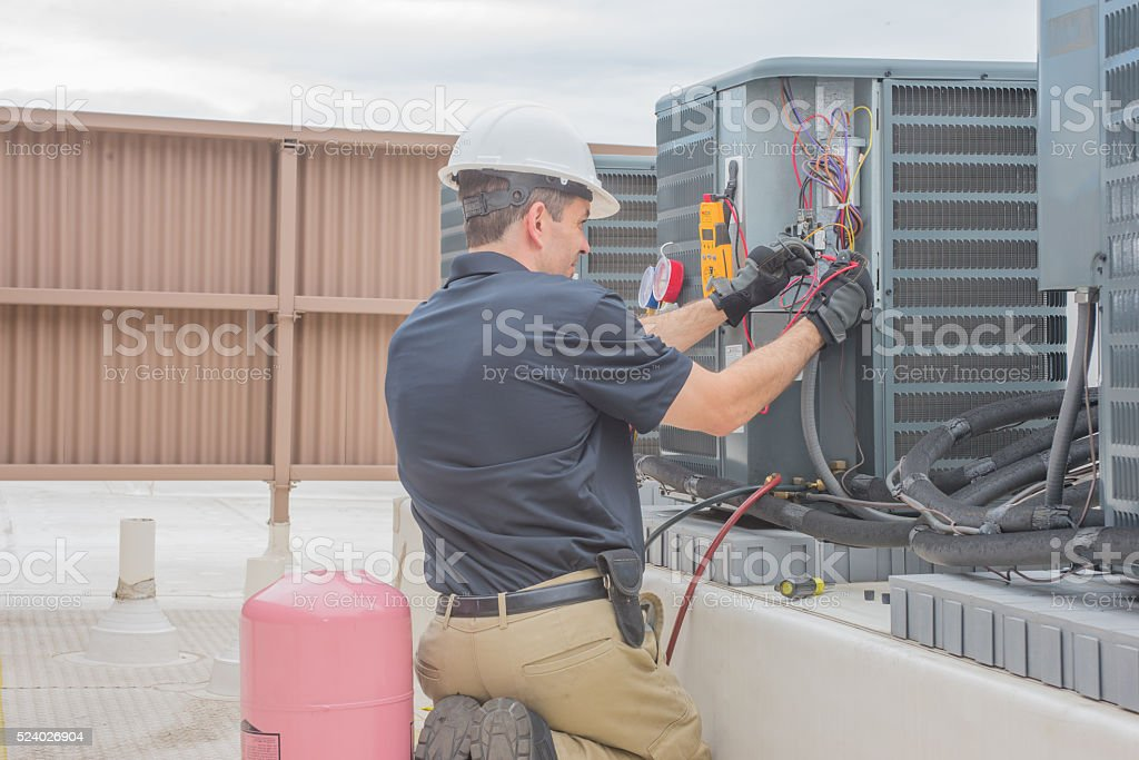 HVAC Tech Checking Condenser stock photo