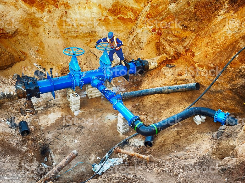 Technical open gate valve on pipes with multi joint members stock photo