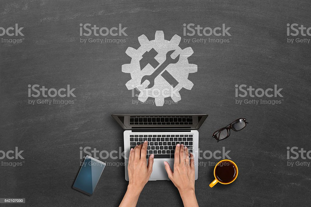 Technical support icon on blackboard stock photo