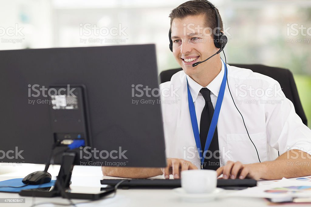 technical support operator working on computer stock photo