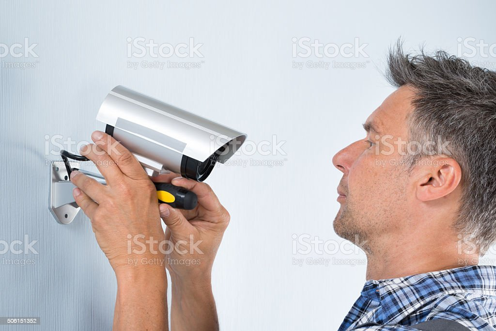Technician Adjusting Cctv Camera stock photo