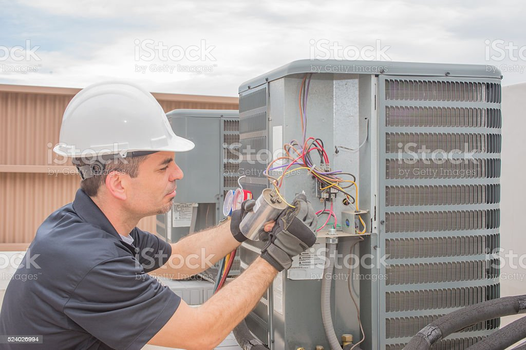 Technician and Capacitor stock photo