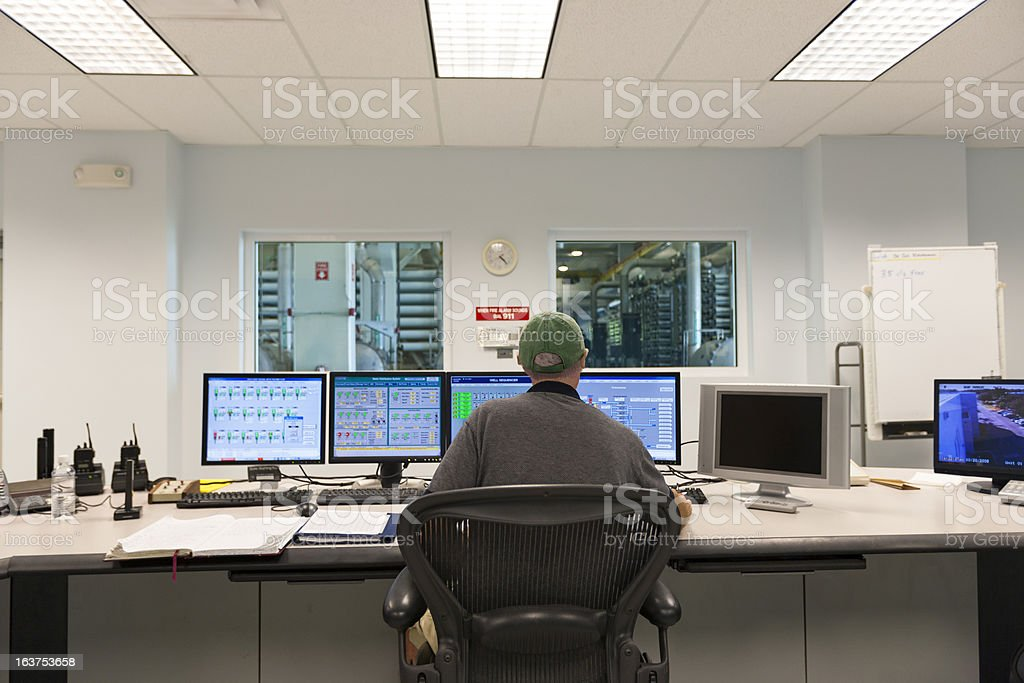 Technician at the Computers in a Control Room royalty-free stock photo
