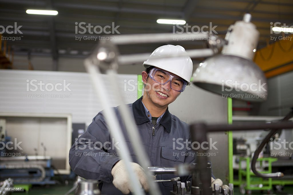 technician at tool workshop royalty-free stock photo
