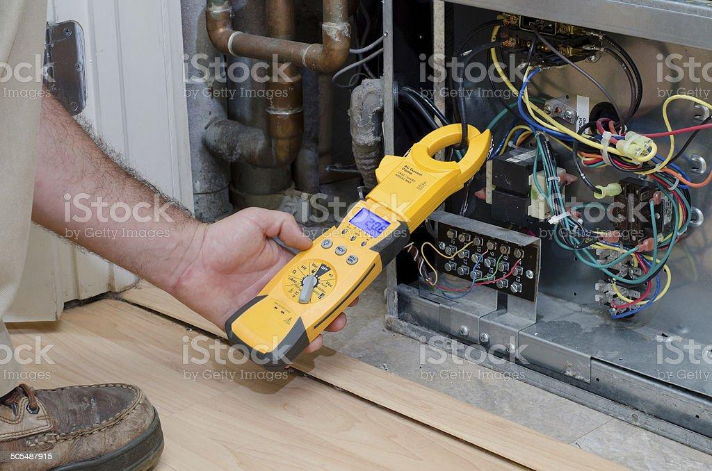Technician checking compressor amps stock photo