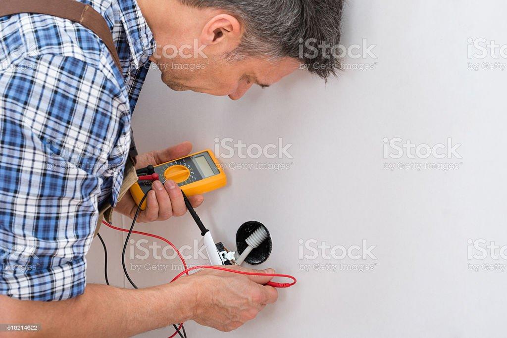 Technician Checking Socket stock photo