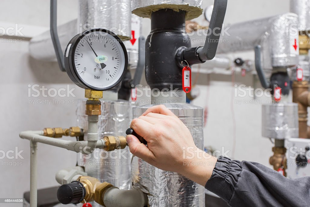 Technician checking water pressure stock photo