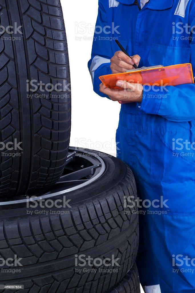 Technician checks tires condition stock photo