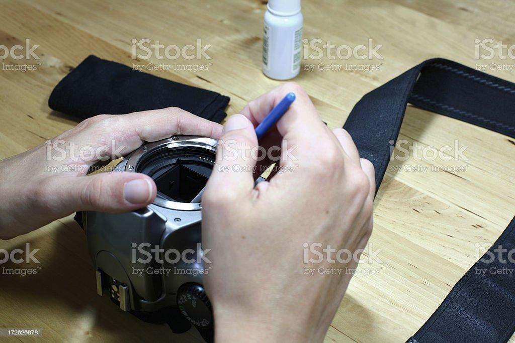 Technician cleaning a digital SLR sensor royalty-free stock photo