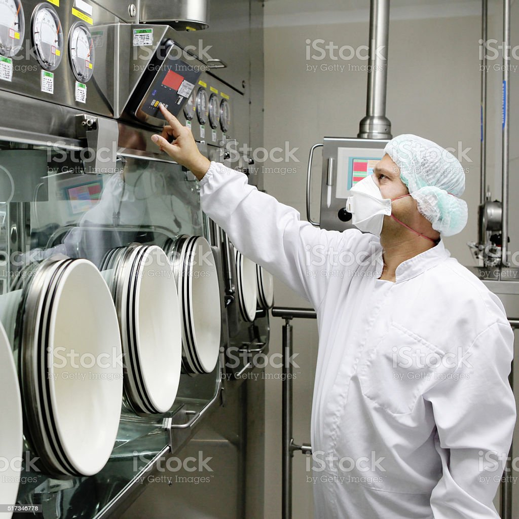Technician controlling industry machine stock photo