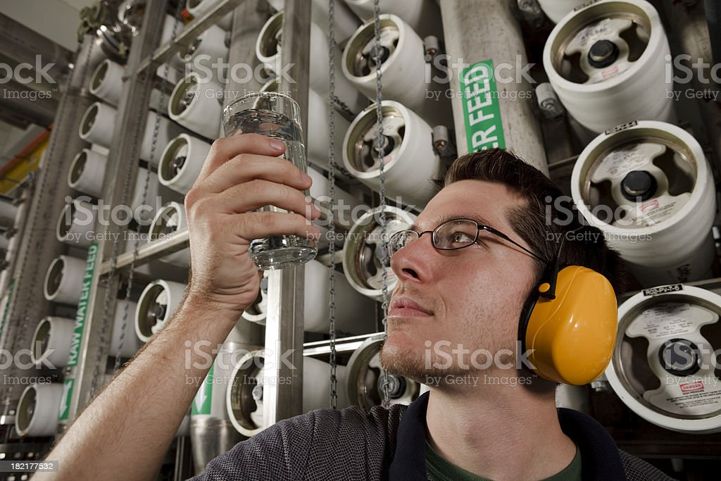 Technician Does Quality Check in Reverse Osmosis Water Purification Plant stock photo