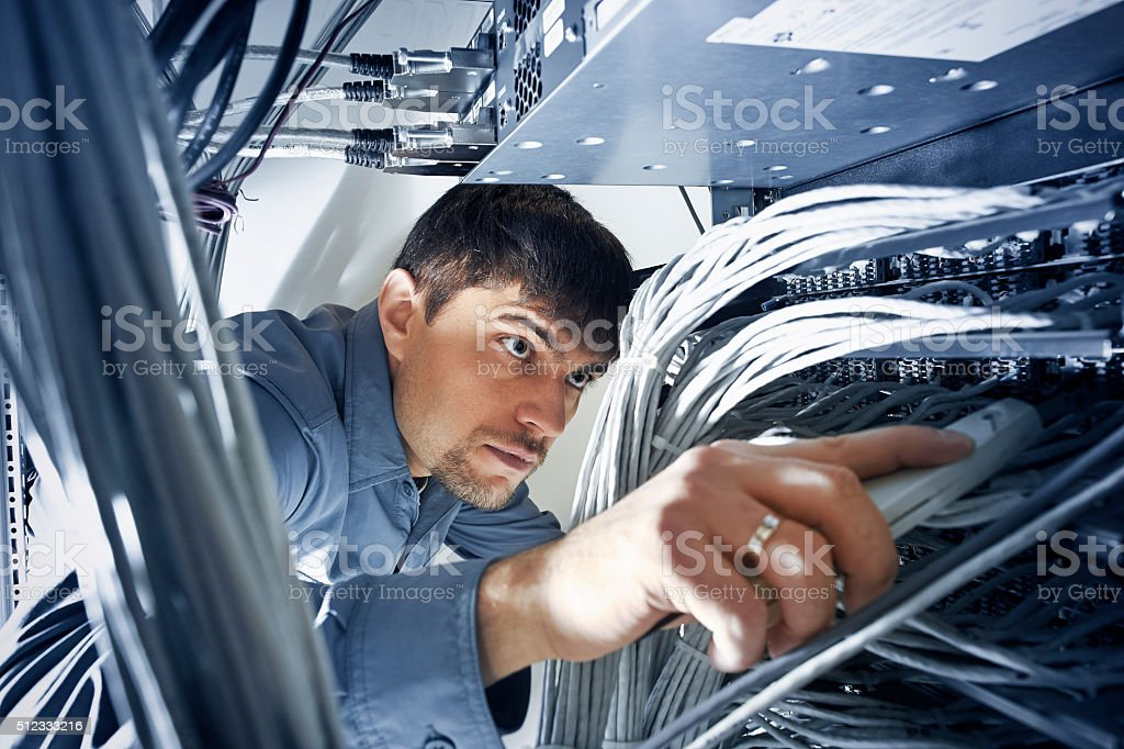 Technician engeneer is checking server's wires in data center stock photo