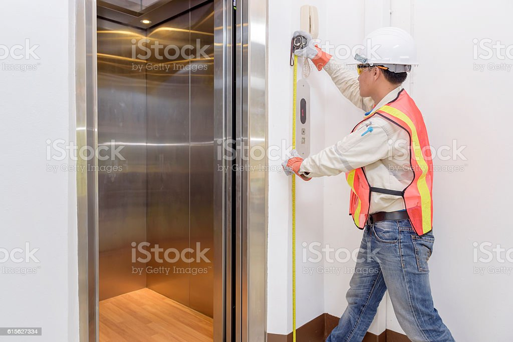 Technician - Engineer investigate work adjustment mechanism lift stock photo