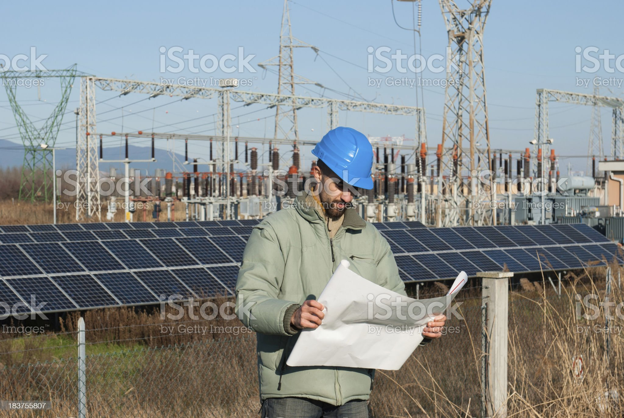 Technician engineer looking a painting solar panels royalty-free stock photo