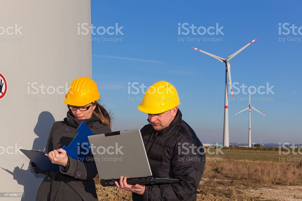 Technician Engineers in a Wind Turbine Power Generation Station royalty-free stock photo