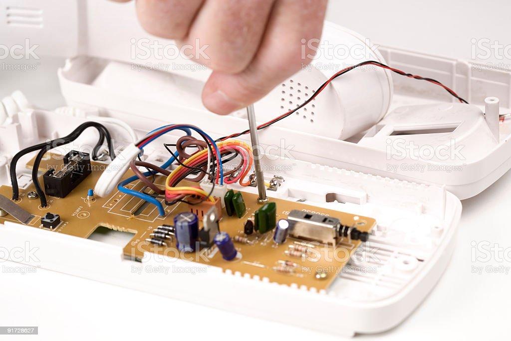 Technician fixing intercom royalty-free stock photo
