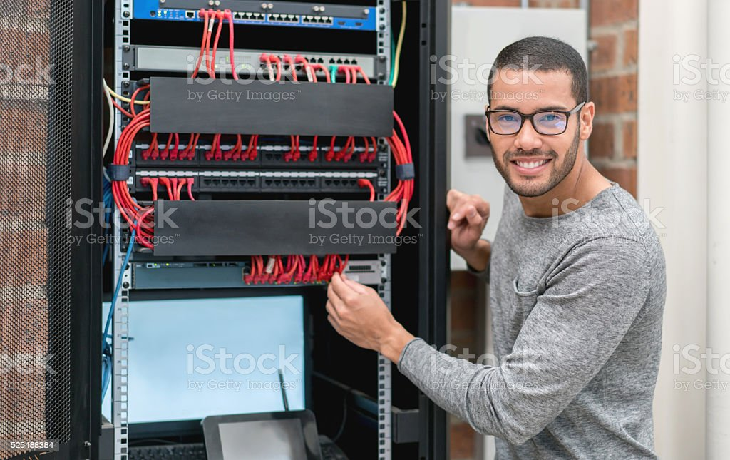 IT technician fixing intranet at the office stock photo