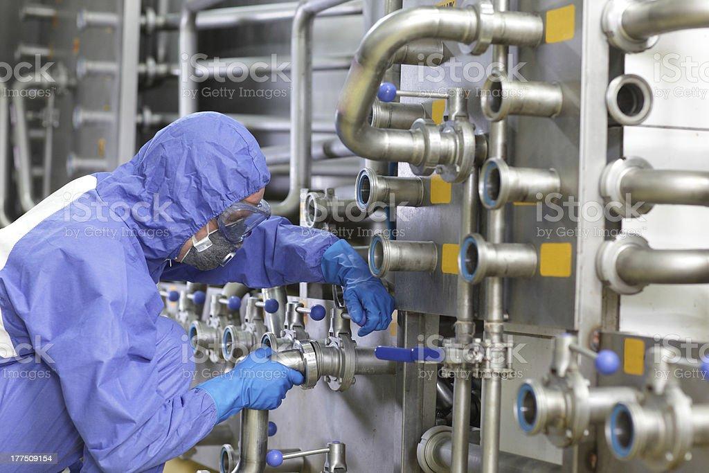 Technician fixing valves in plant stock photo