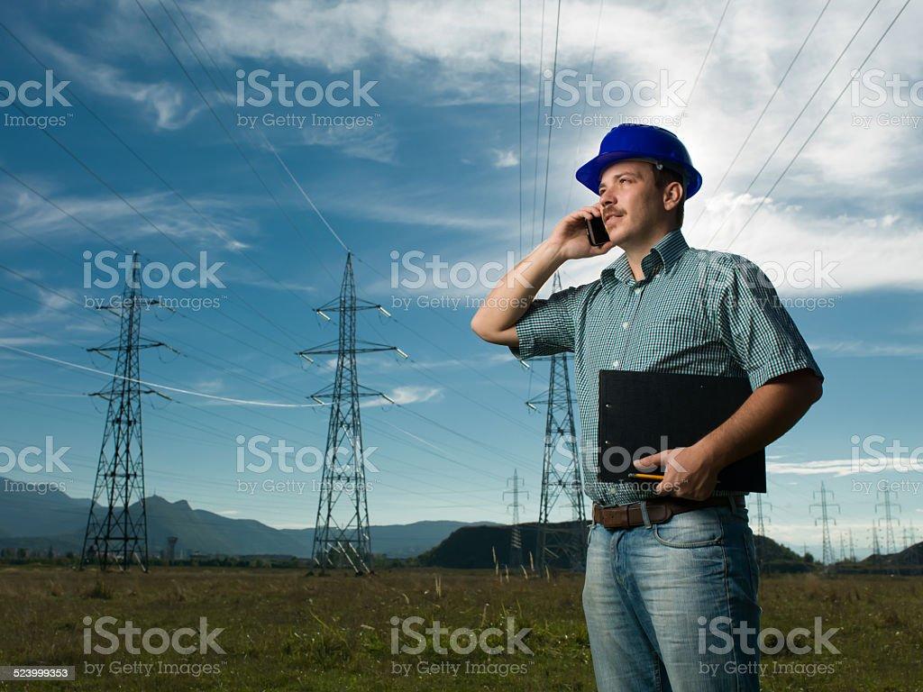technician having conversation on phone stock photo
