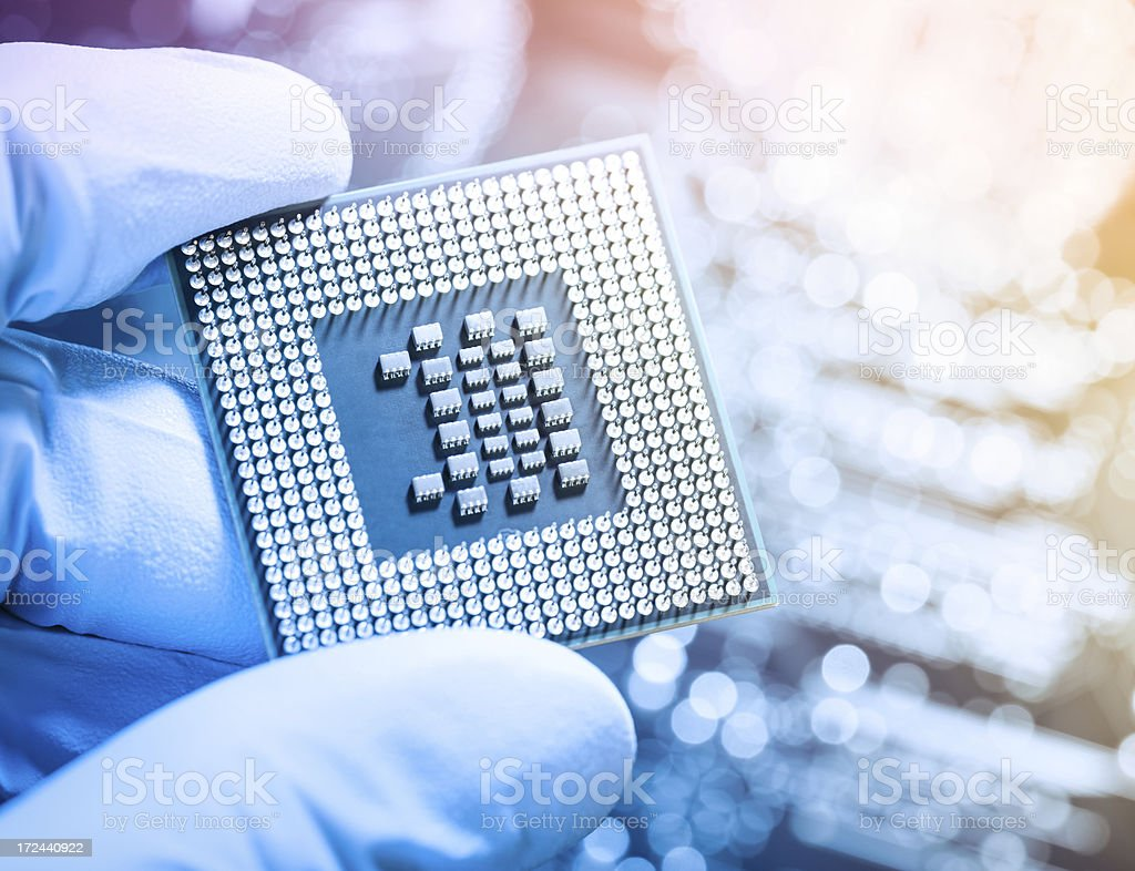 Technician holding chip stock photo