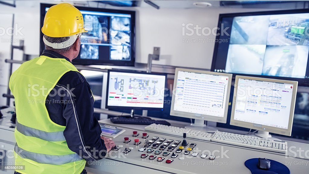 Technician in control room stock photo