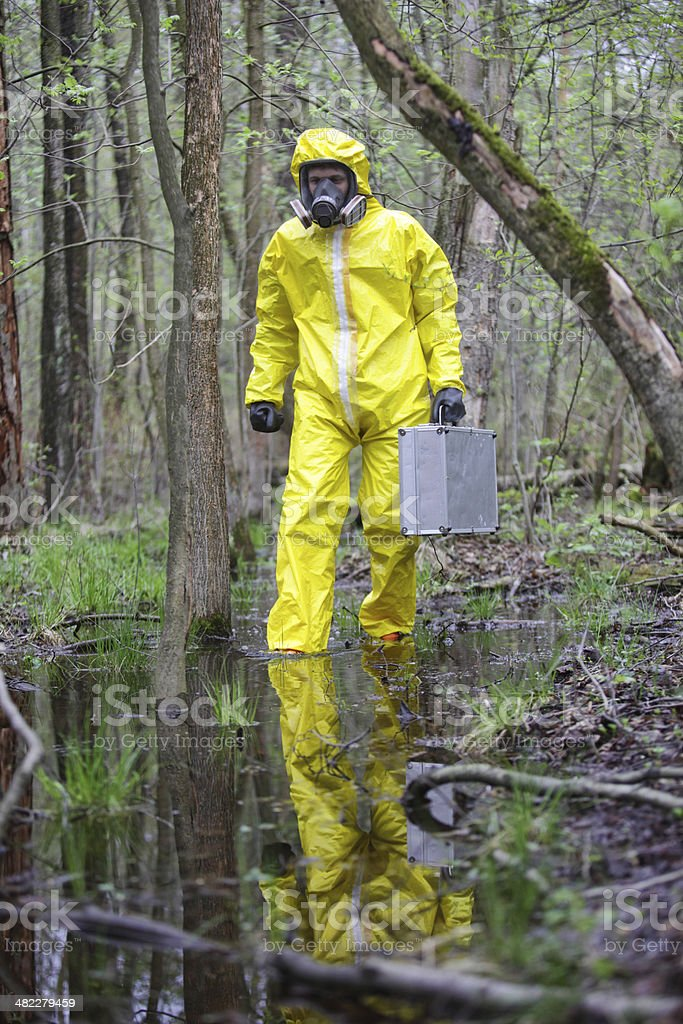 technician in professional uniform in forest royalty-free stock photo