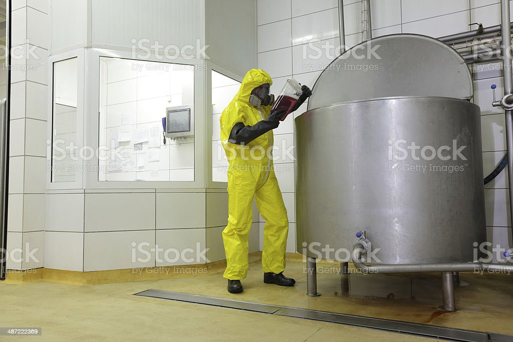 technician in protective uniform working in industrial environment stock photo