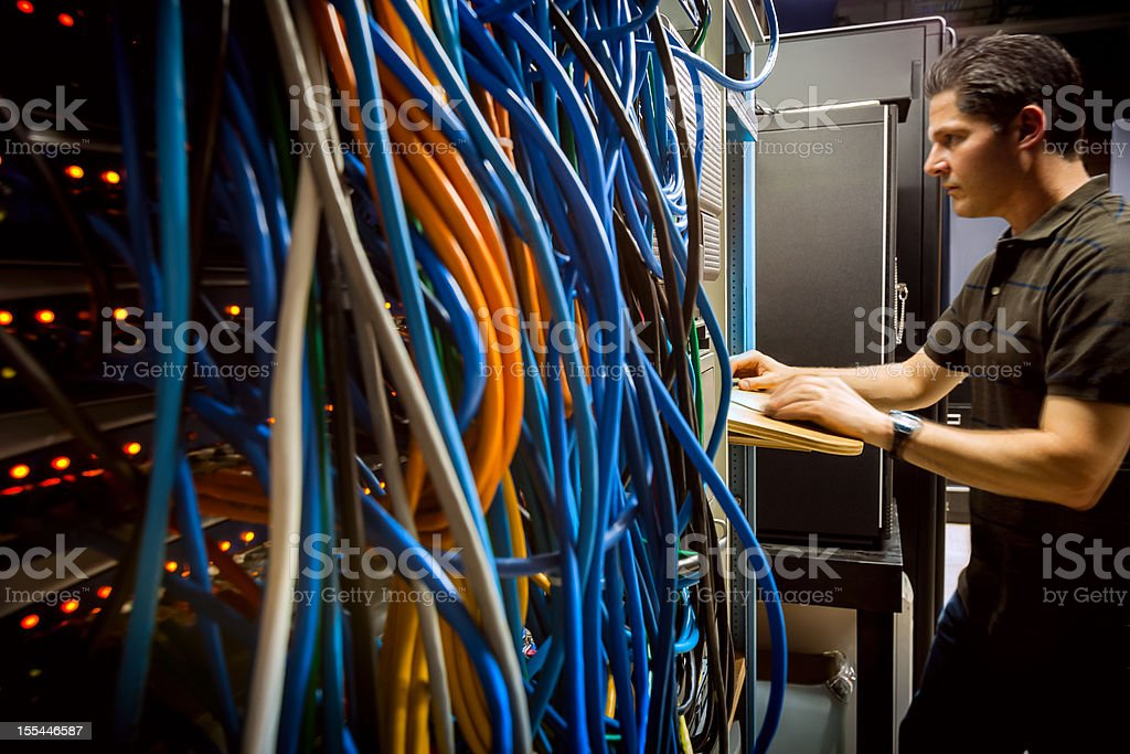 IT Technician in Server Equipment Room at Computer stock photo