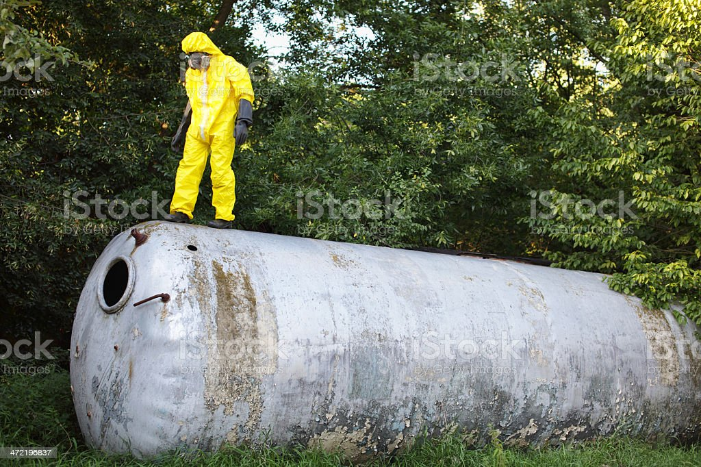 technician in uniform examining large stainless tank stock photo