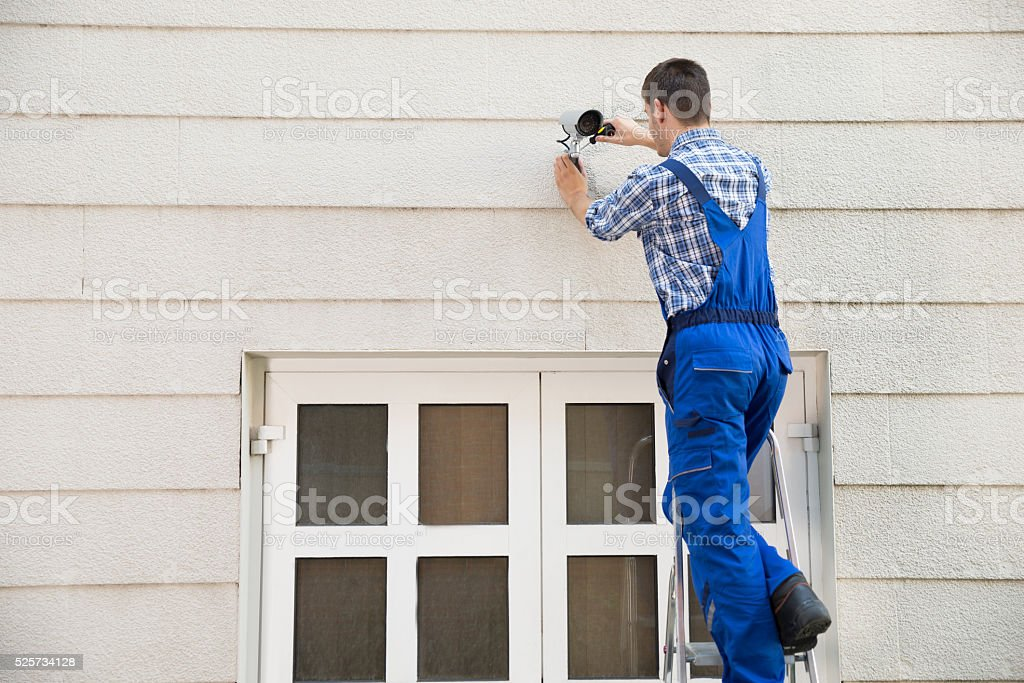 Technician Installing Cctv Camera stock photo