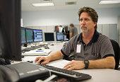 Technician Operates Computer in a Control Center
