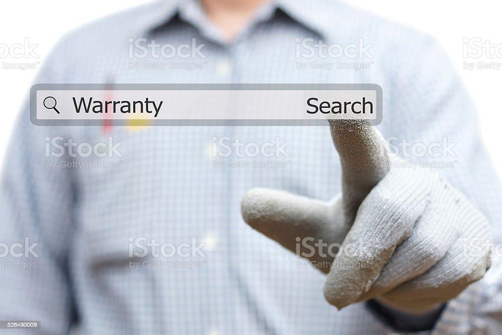 technician pressing warranty word in search bar stock photo