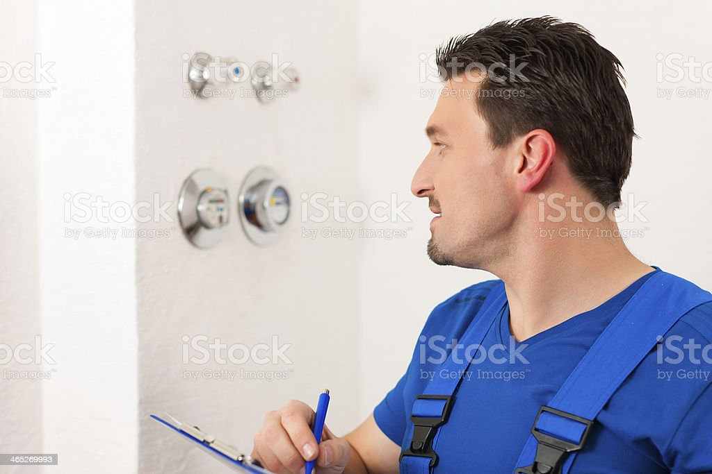 Technician reading the water meter royalty-free stock photo