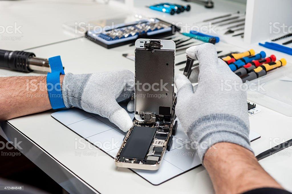 Technician repairing a smarphone stock photo