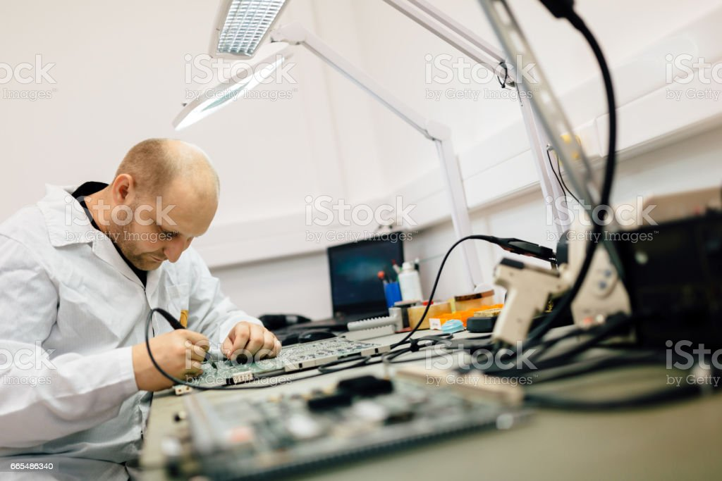 Technician repairing cmts networking cards stock photo