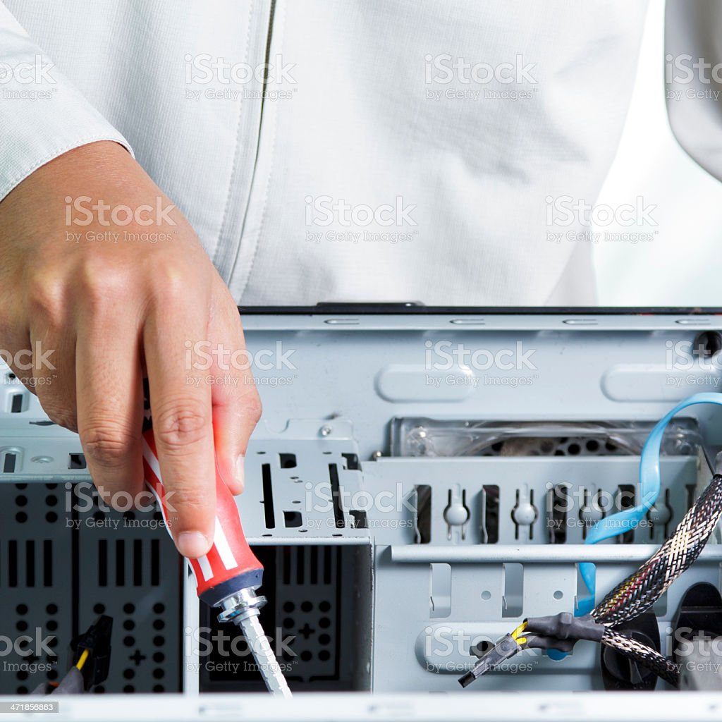 Technician repairing computer hardware royalty-free stock photo