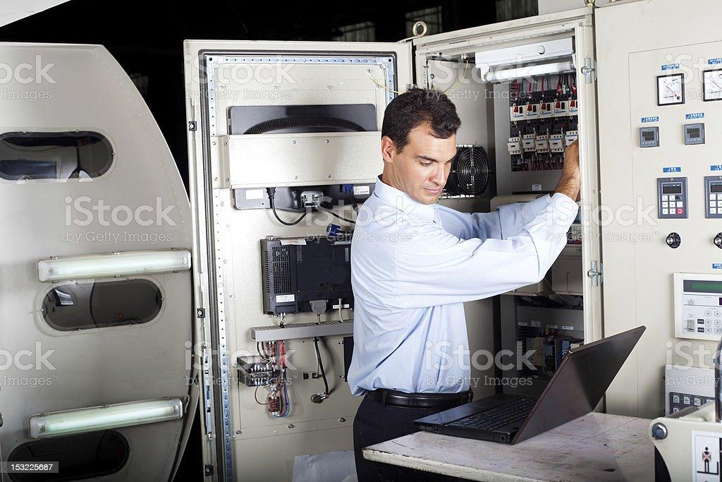 technician repairing modern computerized machine stock photo