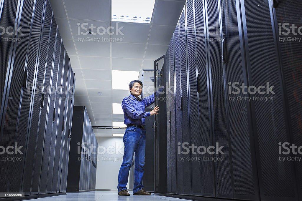 IT Technician Repairing Server royalty-free stock photo