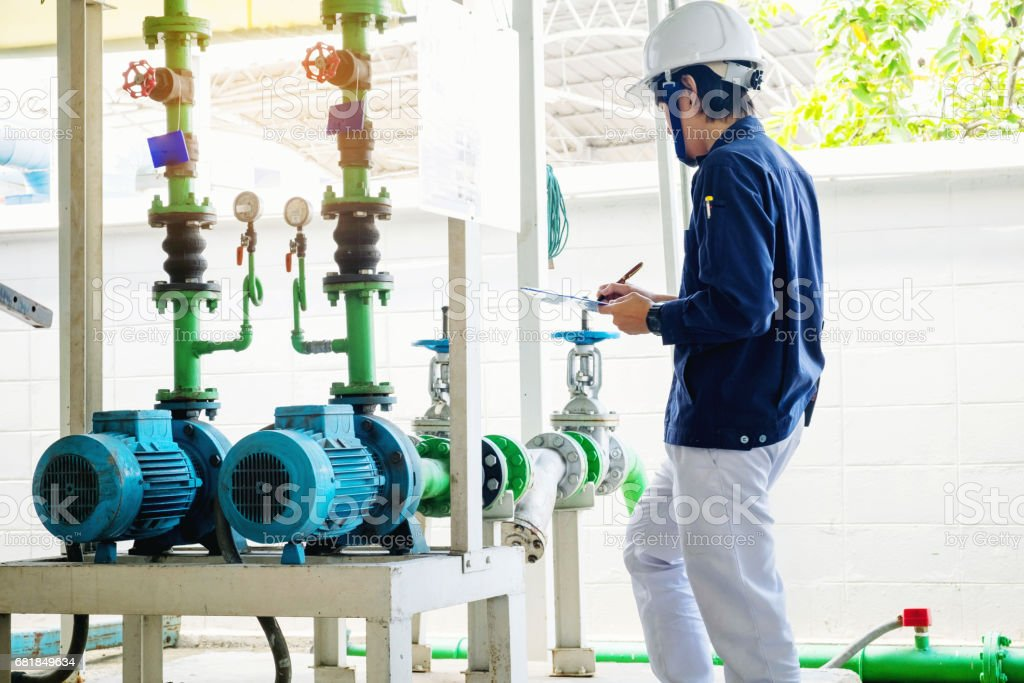 Technician servicing an water Motor Cooling Tower in factory stock photo