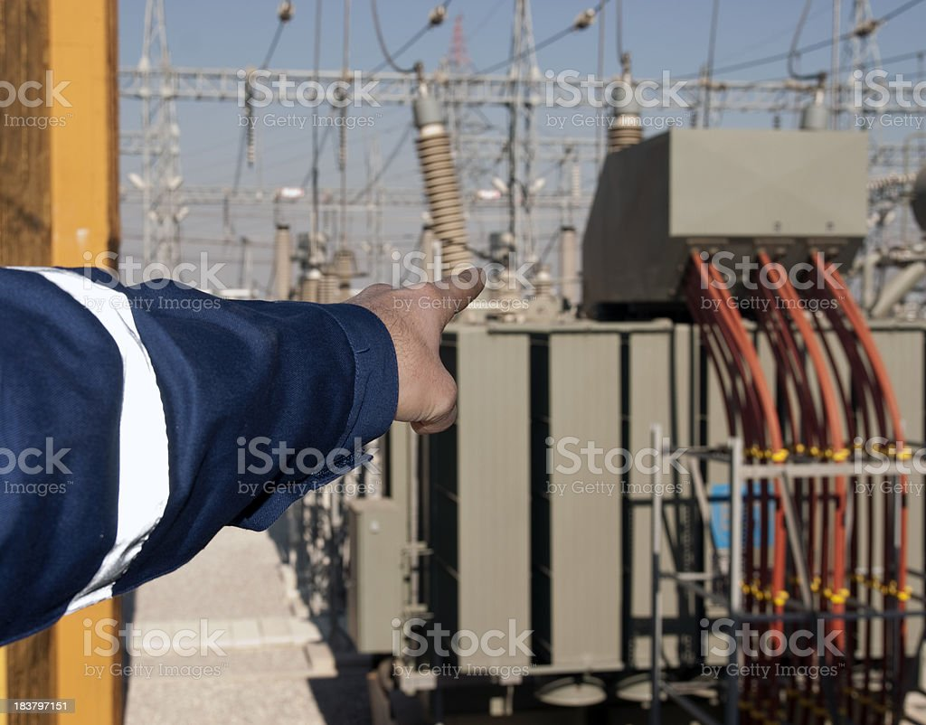technician shows the power transformers stock photo