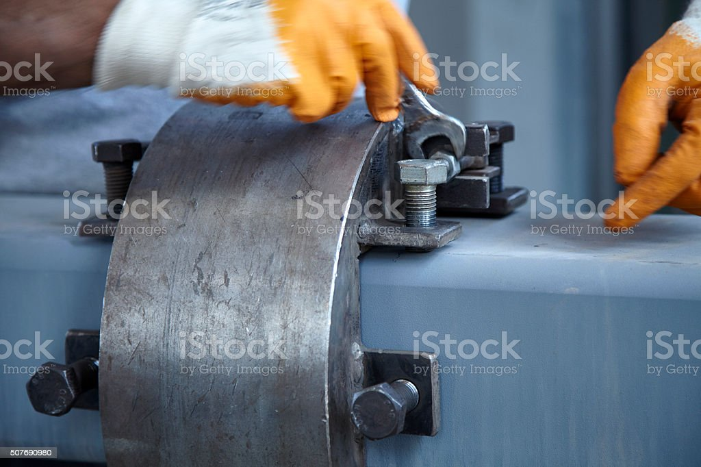 Technician squeezing the bolt stock photo