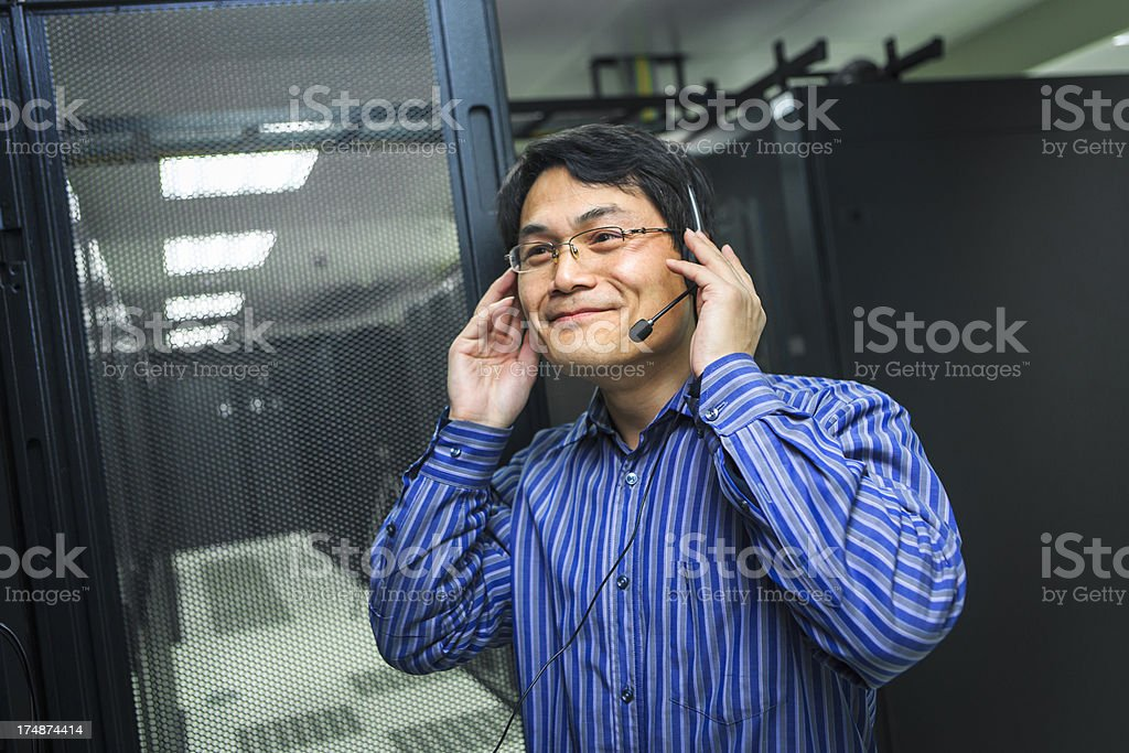 IT Technician With  Headsets royalty-free stock photo