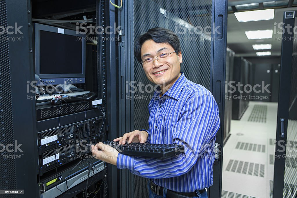 IT Technician With  keyboard stock photo