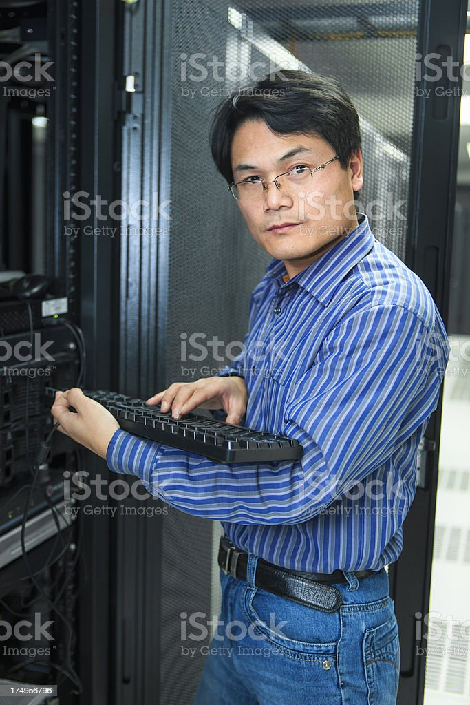 IT Technician With keyboard royalty-free stock photo