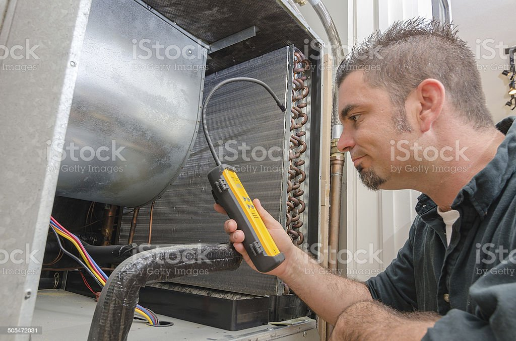 HVAC Technician with Leak Detector stock photo