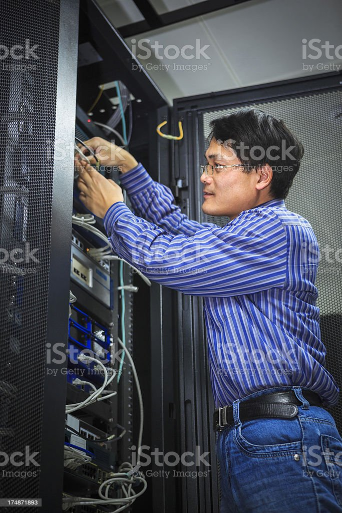 IT Technician With Server Cables royalty-free stock photo