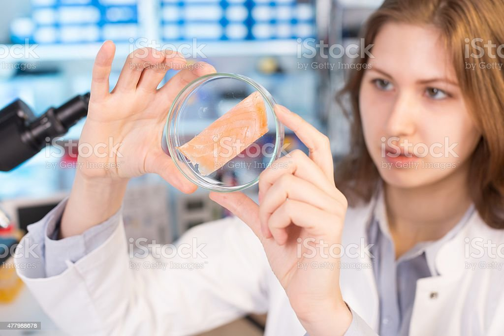 Technician woman In the laboratory tests the food quality stock photo
